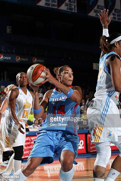Erika de Souza of the Atlanta Dream drives past Swin Cash and Tamera Young of the Chicago Sky on August 17 2012 at the Allstate Arena in Rosemont...