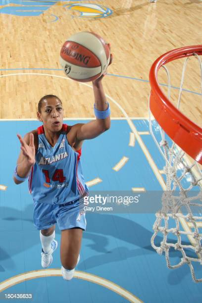 Erika de Souza of the Atlanta Dream goes to the basket on a breakaway during the game against the Chicago Sky on August 17 2012 at the Allstate Arena...