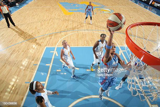Erika de Souza of the Atlanta Dream goes to the basket past Tamera Young Courtney Vandersloot and Epiphanny Prince of the Chicago Sky on August 17...