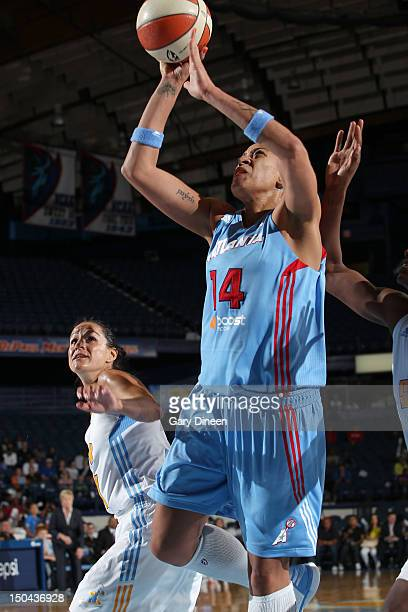 Erika de Souza of the Atlanta Dream goes to the basket past Ticha Penicheiro of the Chicago Sky on August 17 2012 at the Allstate Arena in Rosemont...