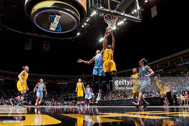 Erika de Souza of the Atlanta Dream reaches for a rebound against Vicki Baugh of the Tulsa Shock during the WNBA game on July 31 2014 at the BOK...