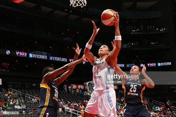 Erika de Souza of the Atlanta Dream shoots over Karima Christmas of the Indiana Fever and Marissa Coleman of the Indiana Fever during the 1st quarter...