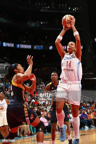 Erika de Souza of the Atlanta Dream shoots over Krystal Thomas of the Indiana Fever during the 1st quarter of an WNBA game at Philips Arena on May 25...