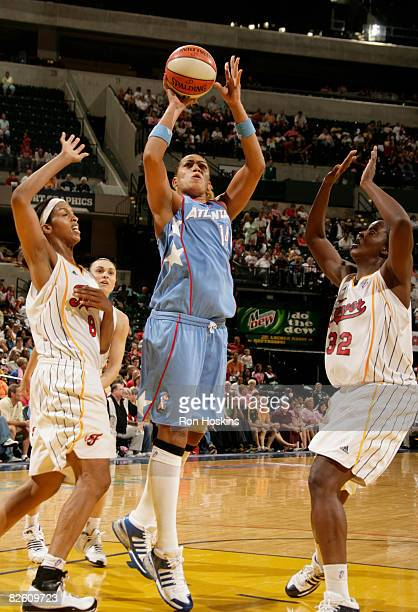 Erika de Souza of the Atlanta Dream shoots over Tammy SuttonBrown and Ebony Hoffman of the Indiana Fever at Conseco Fieldhouse on August 30 2008 in...
