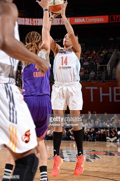Erika de Souza of the Eastern Conference AllStars shoots against Brittney Griner of the Western Conference AllStars during the 2014 Boost Mobile WNBA...