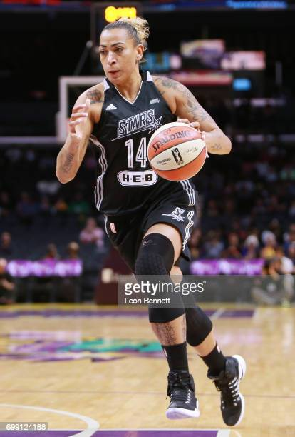 Erika de Souza of the San Antonio Stars handles the ball against the Los Angeles Sparks during a WNBA basketball game at Staples Center on June 15...