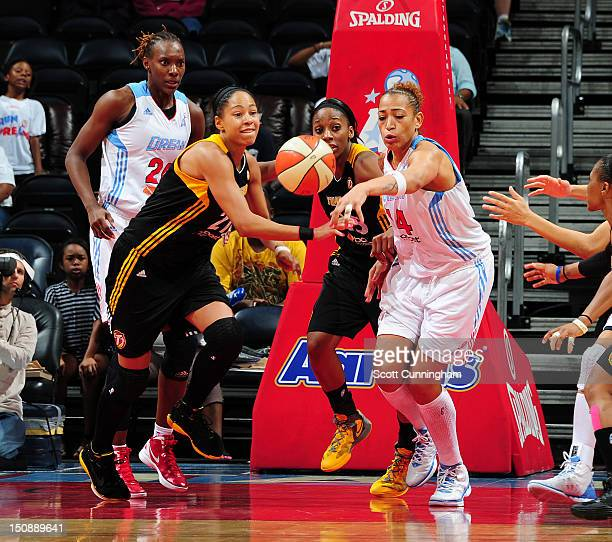 Erika deSouza of the Atlanta Dream battles for a loose ball against Jennifer Lacy of the Tulsa Shock at Philips Arena on August 28 2012 in Atlanta...