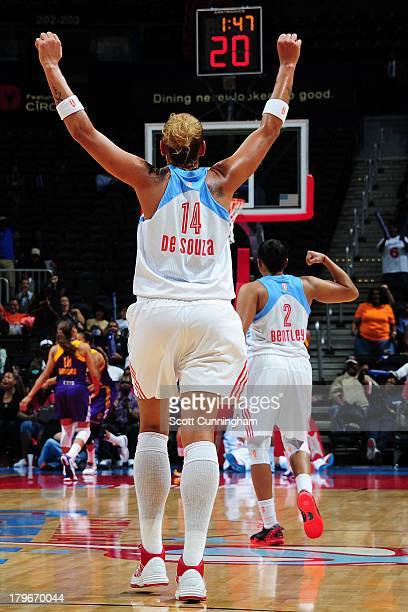 Erika deSouza of the Atlanta Dream celebrates after a score against the Los Angeles Sparks at Philips Arena on September 2 2013 in Atlanta Georgia...