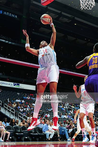 Erika deSouza of the Atlanta Dream grabs a rebound against the Los Angeles Sparks at Philips Arena on September 2 2013 in Atlanta Georgia NOTE TO...