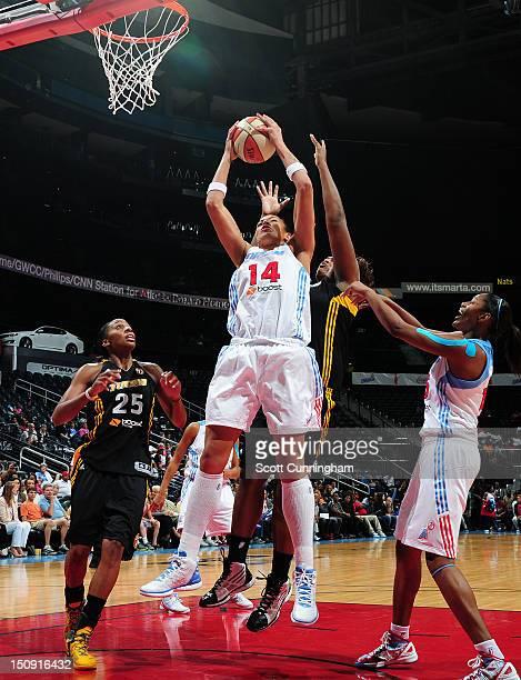 Erika deSouza of the Atlanta Dream grabs a rebound against the Tulsa Shock at Philips Arena on August 28 2012 in Atlanta Georgia NOTE TO USER User...