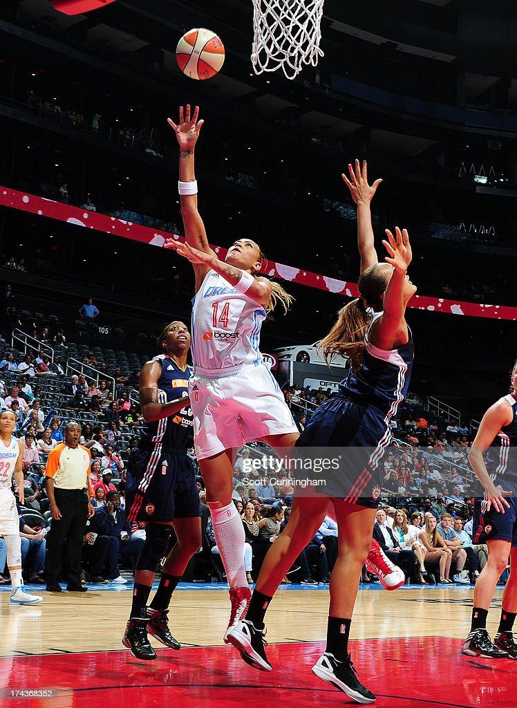 Erika deSouza #14 of the Atlanta Dream puts up a shot against the Connecticut Sun at Philips Arena on July 24, 2013 in Atlanta, Georgia.