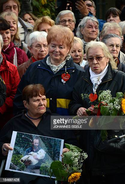Erika Doerflein mother of the zoo keeper Thomas holds a picture of her son during the unveilung of Knut The Dreamer sculpture by German artist Josef...