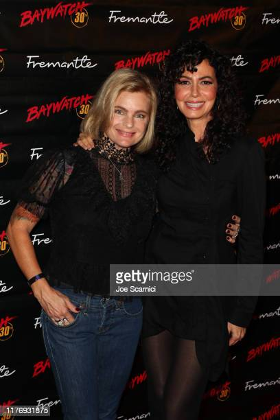 Erika Eleniak and Nancy Valen arrive at the 30th Anniversary Of Baywatchˆ at the Viceroy Hotel on September 24 2019 in Santa Monica California