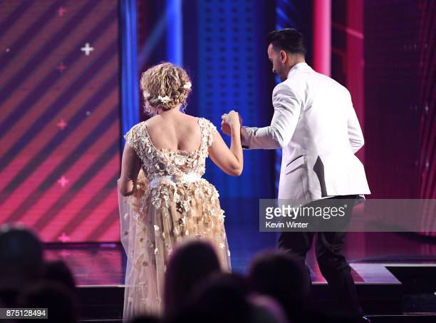 Erika Ender and Luis Fonsi walk onstage to accept Song of the Year for 'Despacito' at the 18th Annual Latin Grammy Awards at MGM Grand Garden Arena...