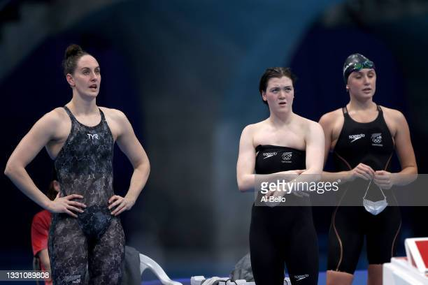 Erika Fairweather, Carina Doyle and Eve Thomas of Team New Zealand react after heat two of the Women's 4 x 200m Freestyle Relay on day five of the...