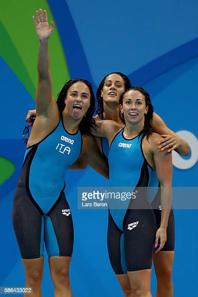 Erika Ferraioli Silvia Di Pietro and Aglaia Pezzato of Italy celebrate winning heat one of the Women's 4x100m Freestyle Relay on Day 1 of the Rio...