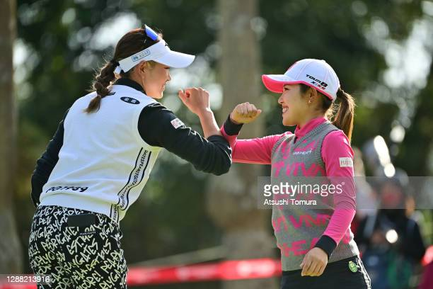 Erika Hara and Ayaka Furue of Japan elbow bump after holing out on the 18th green during the third round of the JLPGA Tour Championship Ricoh Cup at...