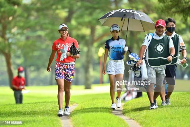 Erika Hara and Yuka Yasuda of Japan walk on their way to the 4th tee during the first round of the NEC Karuizawa 72 Golf Tournament at the Karuizawa...