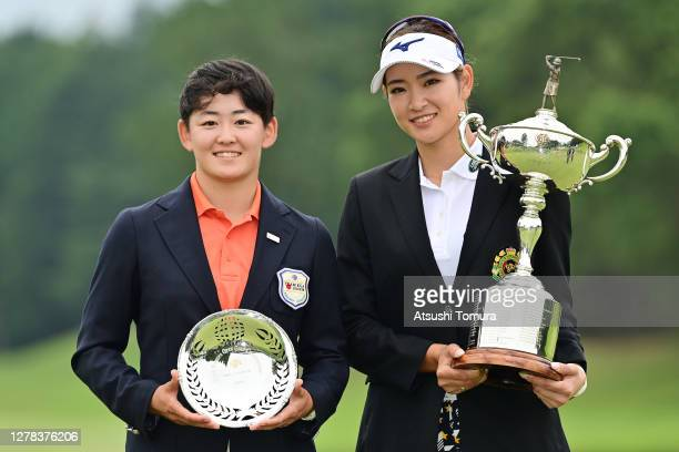 Erika Hara of Japan and Akie Iwai of Japan pose with the trophy after winning the tournament following the final round of the Japan Women's Open Golf...