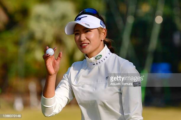 Erika Hara of Japan celebrates winning the tournament on the 18th green during the final round of the JLPGA Tour Championship Ricoh Cup at the...