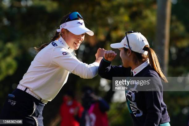 Erika Hara of Japan elbow bumps with Yuna Nishimura after winning the tournament on the 18th green during the final round of the JLPGA Tour...