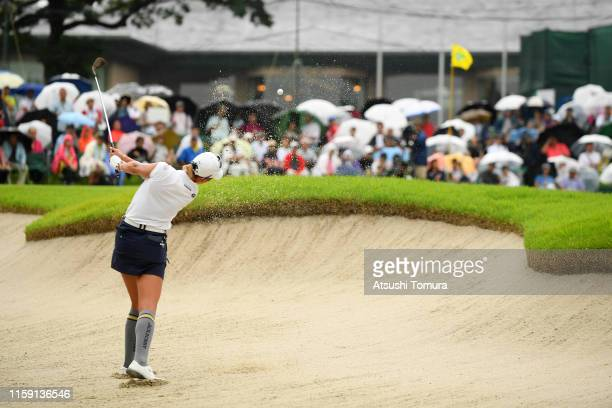 Erika Hara of Japan hits out from a bunker on the 16th hole during the final round of the Earth Mondamin Cup at the Camellia Hills Country Club on...
