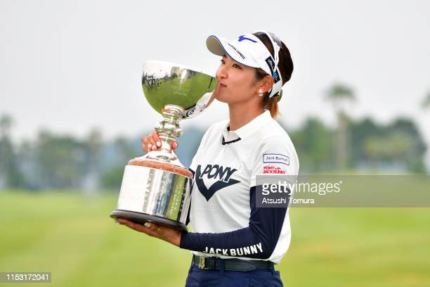 Erika Hara of Japan kisses the trophy after the award ceremony following the final round of the Resorttrust Ladies at Grandi Hamanako Golf Club on...