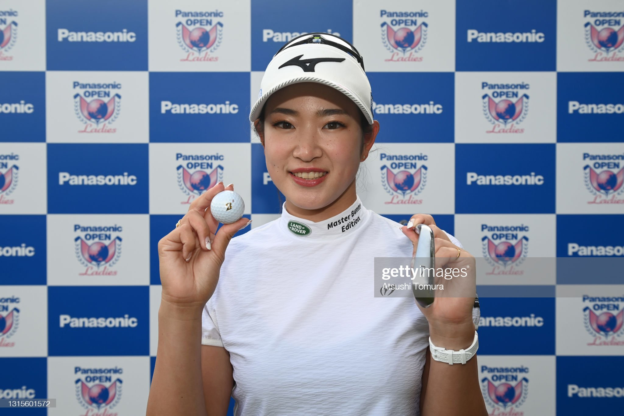 https://media.gettyimages.com/photos/erika-hara-of-japan-poses-for-photographs-as-she-made-a-holeinone-on-picture-id1315601572?s=2048x2048