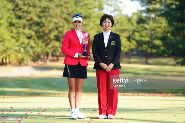 Erika Hara of Japan poses with the JLPGA President Hiromi Kobayashi during the final round of the JLPGA Tour Championship Ricoh Cup at the Miyazaki...