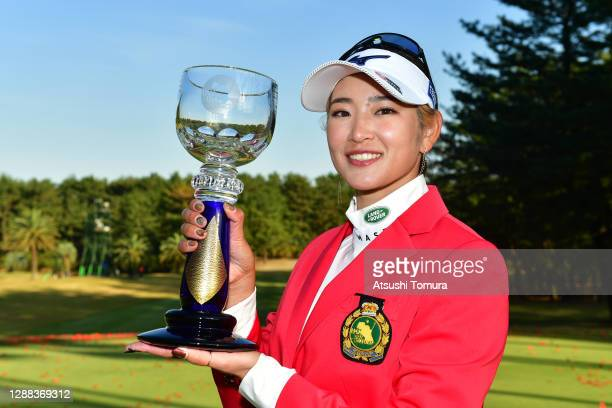 Erika Hara of Japan poses with the JLPGA Tour Championship Trophy after winning the tournament following the final round of the JLPGA Tour...