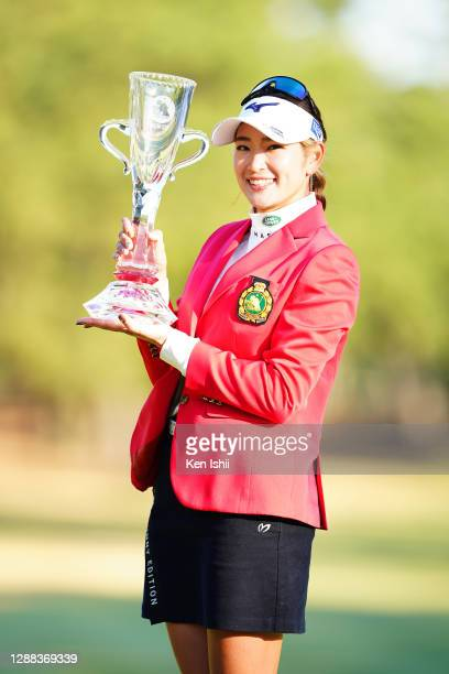 Erika Hara of Japan poses with the Ricoh Cup after winning the tournament following the final round of the JLPGA Tour Championship Ricoh Cup at the...