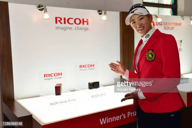 Erika Hara of Japan poses with the Ricoh's winner's prizes after winning the tournament following the final round of the JLPGA Tour Championship...