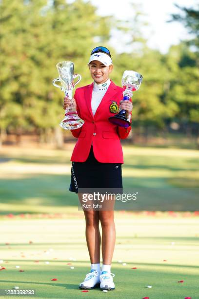 Erika Hara of Japan poses with the trophies after winning the tournament following the final round of the JLPGA Tour Championship Ricoh Cup at the...