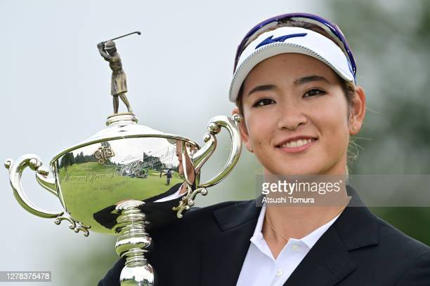 Erika Hara of Japan poses with the trophy after winning the tournament following the final round of the Japan Women's Open Golf Championship at the...