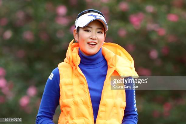 Erika Hara of Japan smiles after her tee shot on the 2nd hole during the final round of the LPGA Tour Championship Ricoh Cup at Miyazaki Country Club...
