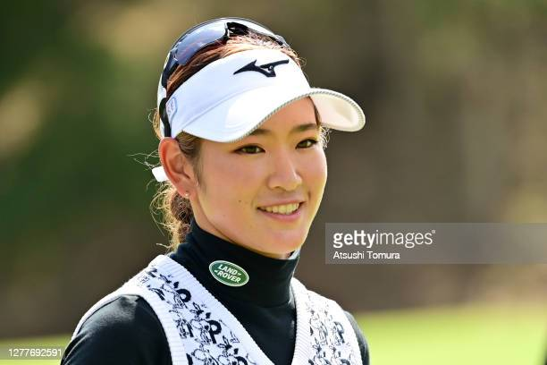 Erika Hara of Japan smiles after holing out on the 9th green during the first round of the Japan Women's Open Golf Championship at the Classic Golf...