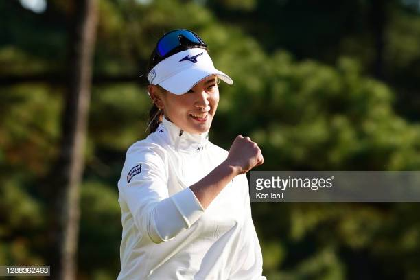 Erika Hara of Japan smiles after winning the tournament on the 18th green during the final round of the JLPGA Tour Championship Ricoh Cup at the...