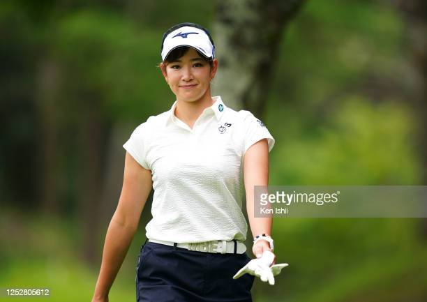 Erika Hara of Japan smiles on her way to the 3rd tee during the third round of the Earth Mondamin Cup at the Camellia Hills Country Club on June 27,...