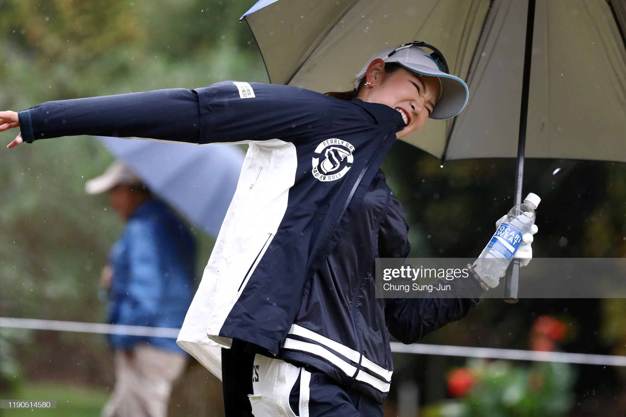 https://media.gettyimages.com/photos/erika-hara-of-japan-wears-a-rain-jacket-after-hitting-a-tee-shot-on-picture-id1190514580?s=2048x2048