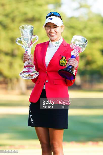Erika Hara of Japan winks after winning the tournament following the final round of the JLPGA Tour Championship Ricoh Cup at the Miyazaki Country...