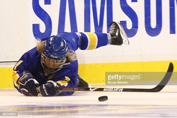Erika Holst of Team Sweden controls the puck against Team Canada during the Hockey Canada Cup at General Motors Place on August 31, 2009 in...