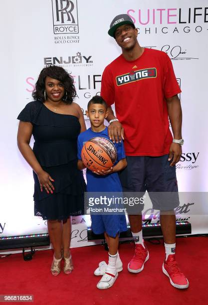 Erika Janee Jordan and Jerome 'Junkyard Dog' Williams attend Suite Life Welcome The BIG 3 NBA Veterans To Chicago at Perillo Rolls Royce on June 28...