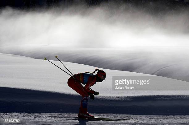 Erika Jislova of Czech Republic skis past the mist in the Women's 75km Pursuit Biathlon during the Winter Youth Olympic Games on January 16 2012 in...