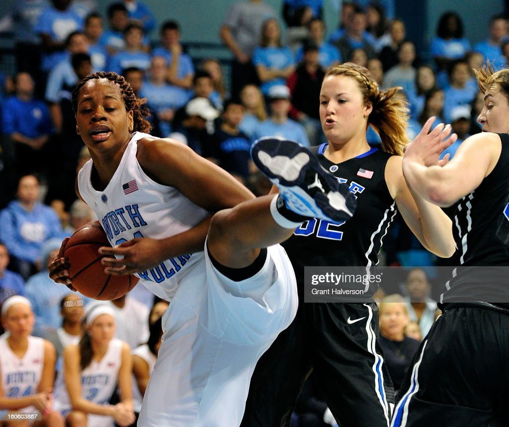 Erika Johnson #31 of the North Carolina Tar Heels takes a rebound away from Tricia Liston #32 of the Duke Blue Devils during play at Carmichael Arena on February 3, 2013 in Chapel Hill, North Carolina.