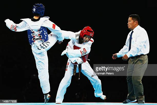 Erika Kasahara of Japan competes against Jingyu Wu of China during the Women's 49kg quarterfinal Taekwondo match on Day 12 of the London 2012 Olympic...