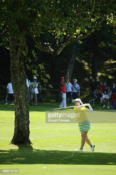Erika Kikuchi of Japan hits her second shot on the 12th hole during the first round of the meiji Cup 2015 at the Sapporo Kokusai Country Club on...