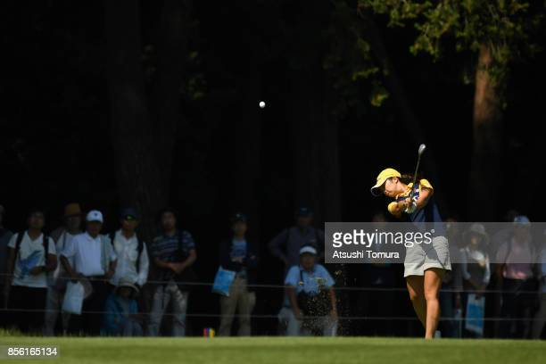 Erika Kikuchi of Japan hits her second shot on the 1st hole during the final round of Japan Women's Open 2017 at the Abiko Golf Club on October 1...