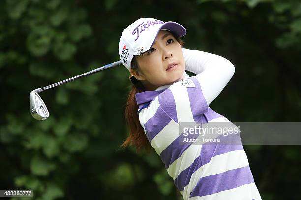 Erika Kikuchi of Japan hits her tee shot on the 7th hole during the second round of the meiji Cup 2015 at the Sapporo Kokusai Country Club on August...