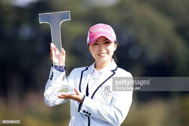 Erika Kikuchi of Japan lifts the Championship's trophy during a ceremony following the TPoint Ladies Golf Tournament at the Wakagi Golf Club on March...