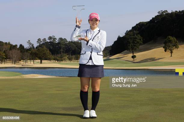 Erika Kikuchi of Japan lifts the Championship's trophy during a ceremony following the T-Point Ladies Golf Tournament at the Wakagi Golf Club on...